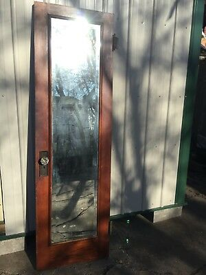 Antique oak interior door w/mirror and glass doorknobs.