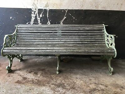 victorian cast iron bench with middle leg and canopy support