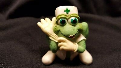 Nurse frog  pulling on gloves RN or LPN cute figurine