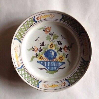 18th century French faience plate painted in colours