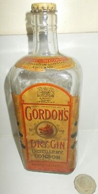 old Gin bottle - Gordons dry Gin London,all labels&Branded cap & 4 OLD SwizzleS