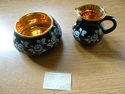 Two pieces of Prinknash - Sugar basin and Milk Jug - decorated with 24ct gold