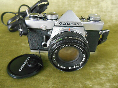 Olympus OM1n 35mm film SLR camera with 50mm 1.8 ZUIKO lens retro