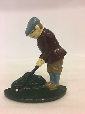 Vintage cast iron golfer playing golf,door stop,book end.