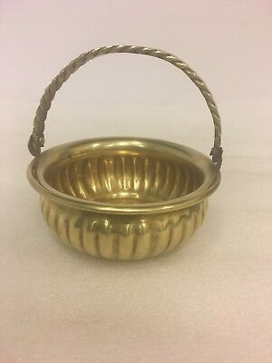 Vintage small solid brass basket, bowl with rope design handle.