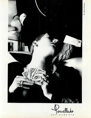 1984 POMELLATO JEWELRY print ad Woman playing cards. Photo by Helmut Newton