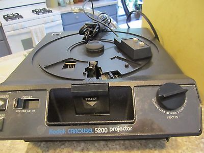 Kodak 5200 carousel slide projector with 6 slide trays and remote
