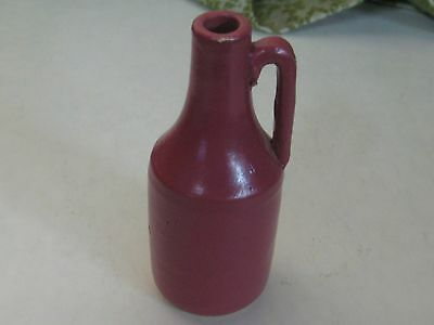 586-1Un Uhl Pottery Jug, Maroon  About 4 Inches Tall