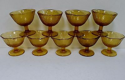 Set of 9 amber crackle glass sherbets with octagon rims