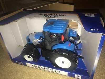 New Holland 1/16th TS125 Dealer Introduction ToyTractor New in Box!