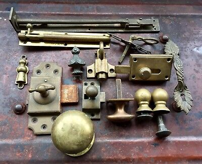 An Interesting Collection Of Antique Brass Door Furniture
