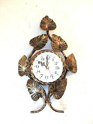 Wall clock with quartz movement wrought iron with leaves gold