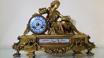19th Century French Ormolu Figural Mantel Clock inset with Sevres Panel.