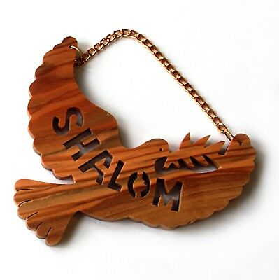 "Olivewood ornament or wall hanging with ""Shalom"" and a dove."