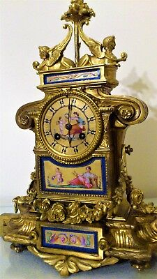 A 19th CENTURY FRENCH ORMOLU & PORCELAIN PANELS MANTEL CLOCK.