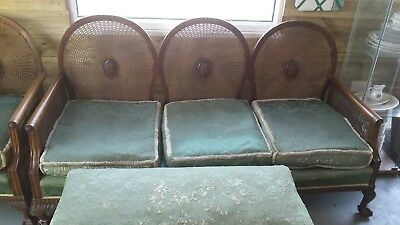 Antique Three piece bergere medallion suite. Settee single chair and footstool