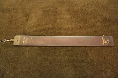 Antique barber chair-razor strop