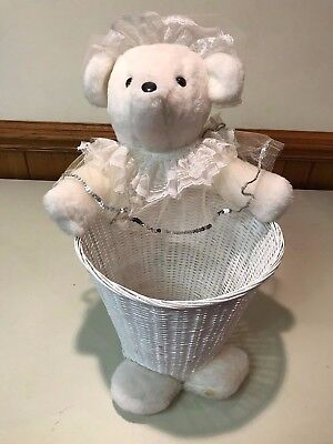 Vintage Teddy Bear with Lace Outfit on a Woven Basket