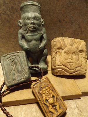 Egyptian statue of Bes and other protection amulets for home and childbirth.