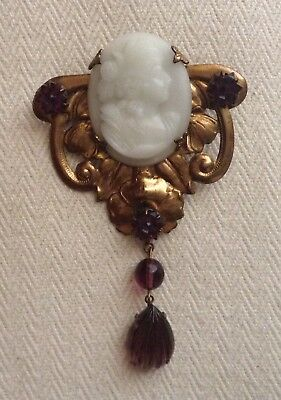 Antique amethyst brooch with cameo stone in soldered brass.