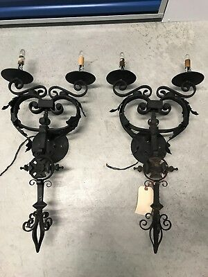 Antique pair of cast iron sconces