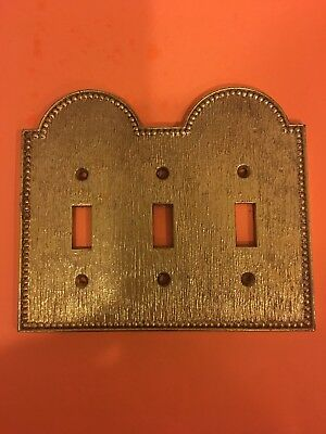 Vintage brass tone metal tripple toggle light switch plate.