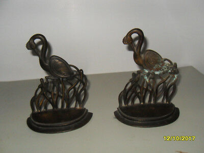 Pair of antique brass or bronze bookends in crane design