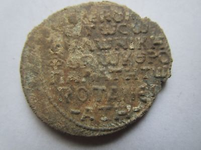 Very rare Byzantine Lead Seal with Bust of Saint and Inscription in 7 lines.