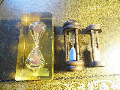 collectable  glass egg timers two wood and one resin low start price