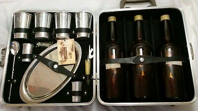 "1960's ""Trav-L-Bar Executair 101 w/key & 3 empty 1940s Seagrams V.O. bottles"