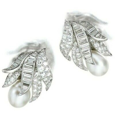 Simulated diamonds, 925 silver & shell pearl earrings.