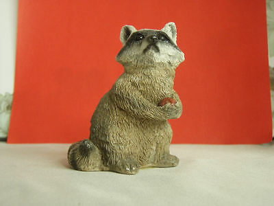 Vintage Stone Critters Raccoon figurine sitting up, holding apple, SCL-120, mint