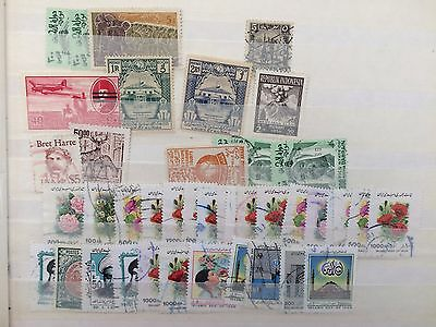 Good middle east assortment of stamps in stock album + strong Juventute Swiss