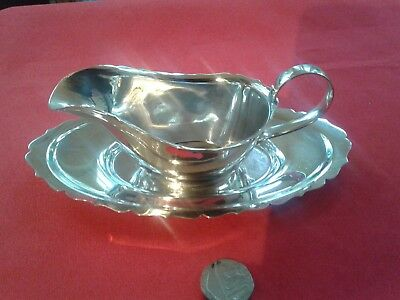 charming little vintage silver plate  sauce boat and tray