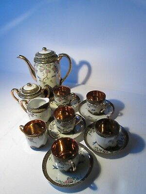 Antique Japanese Eggshell Coffee Set with Full Gilding to Cup Interiors.