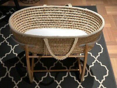 Tom and Milly moses basket and stand in natural wood colour. Can be rocked.