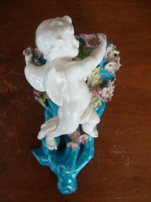 Rare Antique Moore Bros. Porcelain Winged Cherub & Applied Flower Wall Pocket.