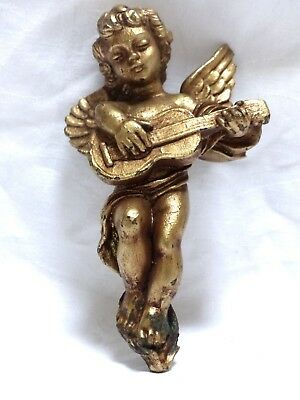 Adorable Angel boy playing music in golden wood, good condition