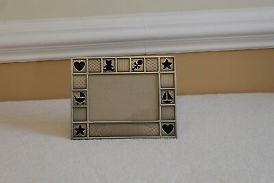 Pewter baby frame that holds 4x6 photo