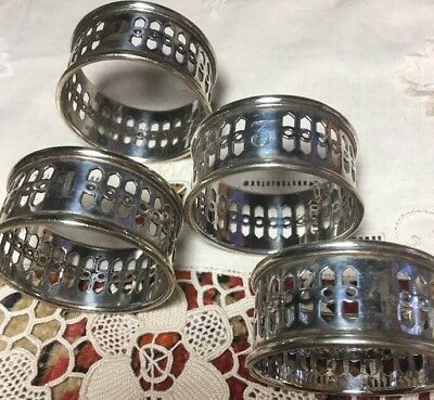 4 Vtg. Napkin Rings likely silver-plated, numbered 1-4; New Orleans Silversmith