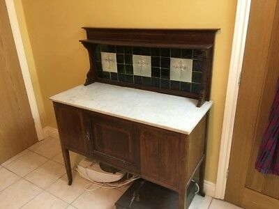 Antique White Marble topped wash stand with beautiful floral tiled Inlay.