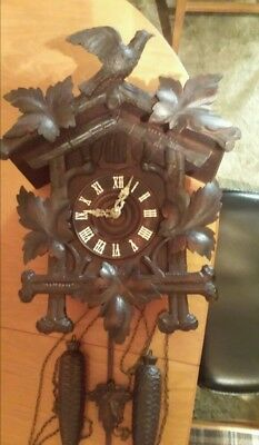 Cucckoo clock black forest.larch..been restored. In good working condition.