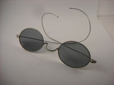 Antique eyeglasses. Sunglasses from the early 1900's.  Small spectacles.
