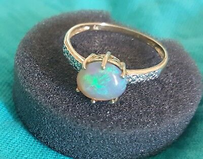 Solid semi black opal and diamond ring 9ct
