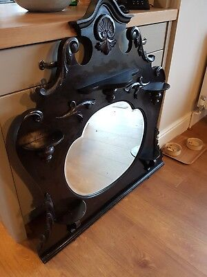 Antique ornate wooden ebonised overmantel mirror