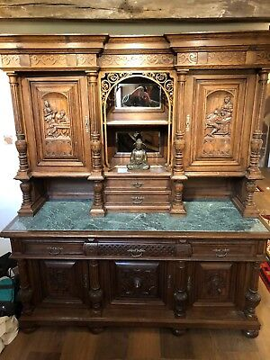 Antique 19th Century oak side board with green marble top with mirrors.