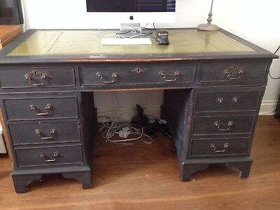 Antique Style Hardwood leather top Partners Desk with black waxed finish.
