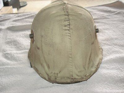 Reproduction German helmet and cover.