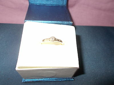 9Ct Y/g Diamond Ring Size R With Diamond On Each Shoulder In Ring Box