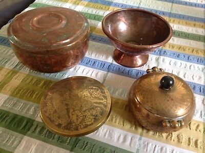 Four small soft metal Indian? bowls/dishes
